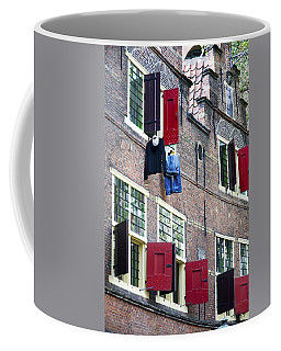 Clothes Hanging From A Window In Kattengat Coffee Mug