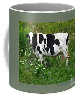 Cow In The Flowers Coffee Mug by Patricia Overmoyer