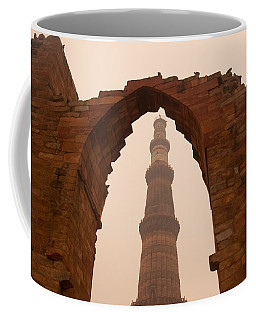 Cross Section Of The Qutub Minar Framed Within An Archway In Foggy Weather Coffee Mug