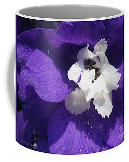 Coffee Mug featuring the photograph Delphinium Named Blue With White Bee by J McCombie