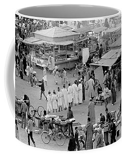 Coffee Mug featuring the photograph Djemaa El Fna Marrakech Morocco by Tom Wurl