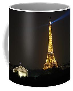 Coffee Mug featuring the photograph Eiffel Tower At Night by Jennifer Ancker
