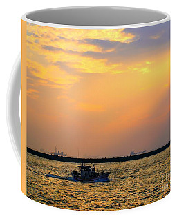 Coffee Mug featuring the photograph Fishing Boat Leaves At Dusk by Yali Shi