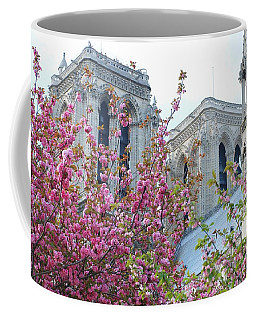 Coffee Mug featuring the photograph Flowering Notre Dame by Jennifer Ancker