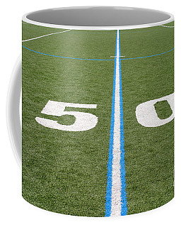 Coffee Mug featuring the photograph Football Field Fifty by Henrik Lehnerer