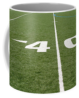 Coffee Mug featuring the photograph Football Field Forty by Henrik Lehnerer