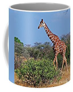 Giraffe Against Blue Sky Coffee Mug