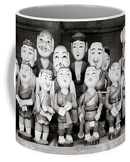 Hanoi Water Puppets Coffee Mug by Shaun Higson