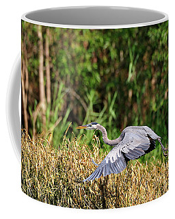 Heron Flying Along The River Bank Coffee Mug