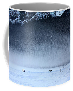 Coffee Mug featuring the photograph Hockey On Lake Louise by Alyce Taylor