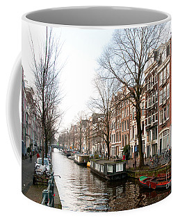 Coffee Mug featuring the digital art Homes Along The Canal In Amsterdam by Carol Ailles