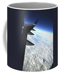 in Orbit Coffee Mug by Micah May