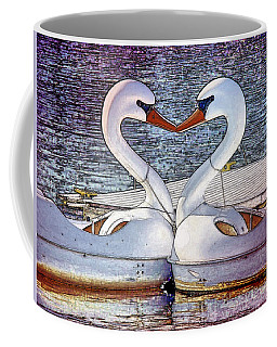 Coffee Mug featuring the photograph Kissing Swans by Alice Gipson