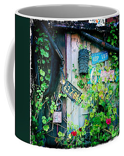 Coffee Mug featuring the photograph License Plate Wall by Nina Prommer