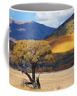 Coffee Mug featuring the photograph Lone Tree by Jim Garrison