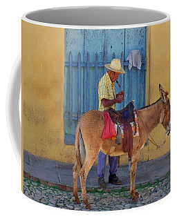 Coffee Mug featuring the photograph Man And A Donkey by Lynn Bolt