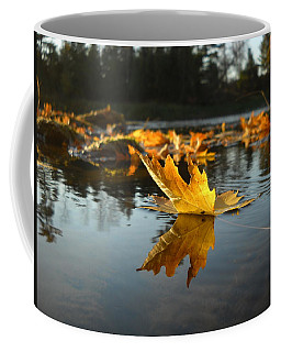 Maple Leaf Floating In River Coffee Mug by Kent Lorentzen
