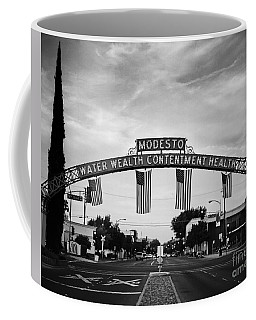 Modesto Arch With Flags Coffee Mug