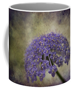 Coffee Mug featuring the photograph Moody Blue by Clare Bambers