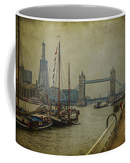 Coffee Mug featuring the photograph Moored Thames Barges. by Clare Bambers