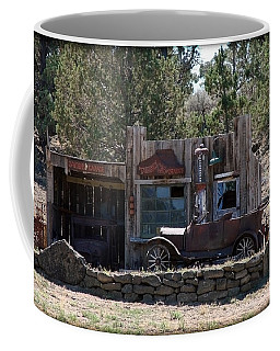 Coffee Mug featuring the photograph Old Filling Station by Athena Mckinzie