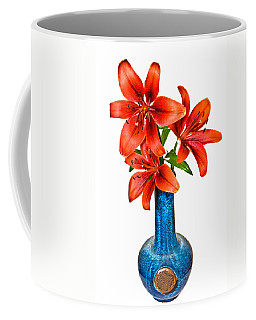 Red Lilies In Blue Vase Coffee Mug