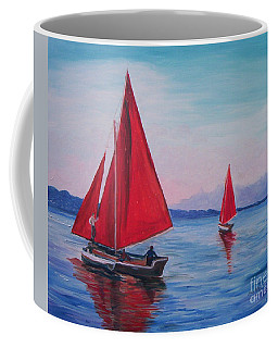Coffee Mug featuring the painting Red Sails On Irish Coast by Julie Brugh Riffey