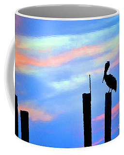 Coffee Mug featuring the photograph Reflections In Water With Pelican by Dan Friend