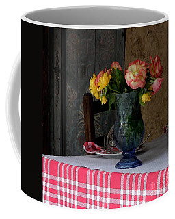 Coffee Mug featuring the photograph Roses In Blue Glass Vase by Lainie Wrightson