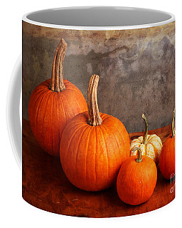 Coffee Mug featuring the photograph Small Decorative Pumpkins by Verena Matthew