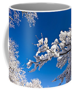 Snowy Trees And Blue Sky Coffee Mug