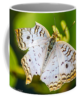 Coffee Mug featuring the photograph Tattered Moth by Shannon Harrington