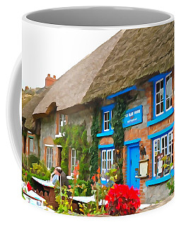 Coffee Mug featuring the photograph The Blue Door by Charlie and Norma Brock