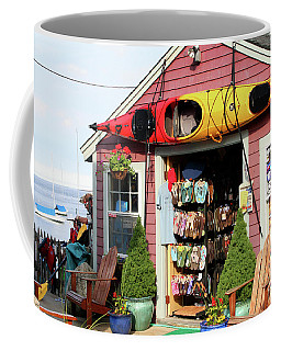 Coffee Mug featuring the photograph The Kayak Store by Adrian LaRoque
