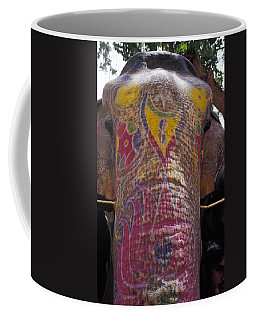 The Painted Face And Trunk Of A Working Coffee Mug