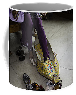 Trying On A Very Large Decorated Shoe Coffee Mug by Ashish Agarwal