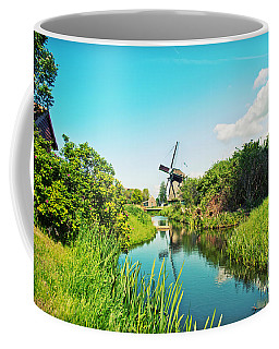 Coffee Mug featuring the photograph Typical Dutch  Windmill by Ariadna De Raadt