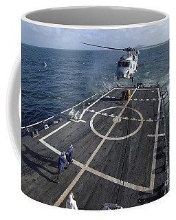 U.s. Navy Sailors Prepare To Attach Coffee Mug