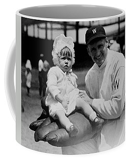 Coffee Mug featuring the photograph Walter Johnson Holding A Baby - C 1924 by International  Images