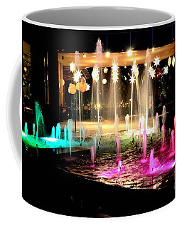 Water Fountain With Stars And Blue Green With Pink Lights Coffee Mug