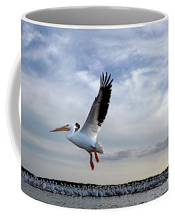 Coffee Mug featuring the photograph White Pelican Flying Over Island by Dan Friend