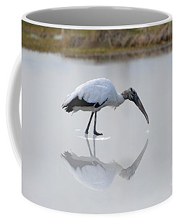 Coffee Mug featuring the photograph Wood Stork Eating by Dan Friend