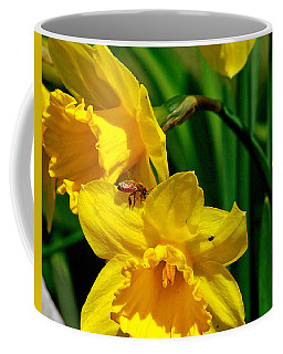 Coffee Mug featuring the photograph Yellow Daffodils And Honeybee by Kay Novy