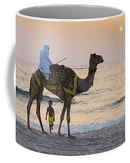 Little Boy Stares In Amazement At A Camel Riding On Marina Beach In Dubai, United Arab Emirates -  Coffee Mug
