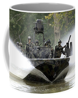 Coffee Mug featuring the photograph A Special Operations Craft Riverine by Stocktrek Images