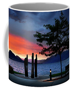 Coffee Mug featuring the photograph A Sunset Story by John Poon