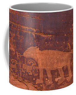 Coffee Mug featuring the photograph Ancient Native American Petroglyphs On A Canyon Wall Near Moab. by Jim Thompson