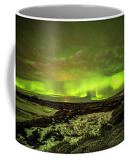 Aurora Borealis Over A Frozen Lake Coffee Mug by Joe Belanger