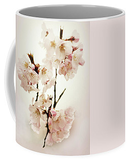 Coffee Mug featuring the photograph Blushing Blossom by Jessica Jenney
