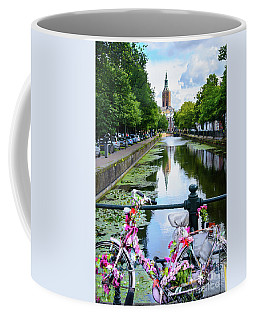 Coffee Mug featuring the digital art Canal And Decorated Bike In The Hague by RicardMN Photography